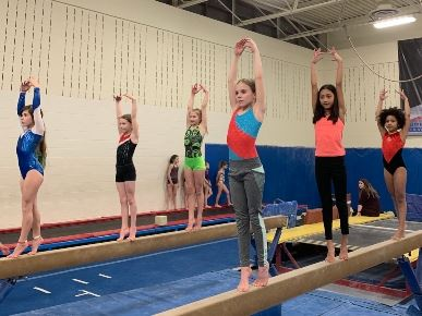 girls on beam